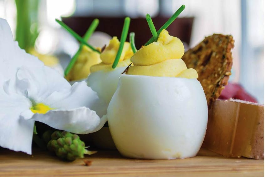 Cutting a small slice from the bottoms of hard-cooked eggs allows you to stand them upright, giving a fun, fresh look to your deviled eggs. Photo: Lisa Dawn Bolton