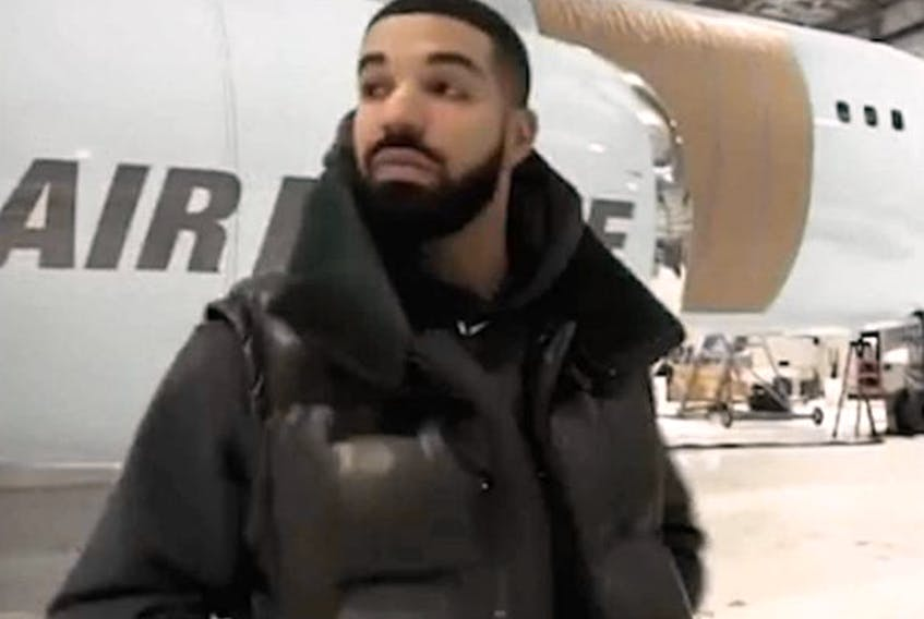 Drake standing in front of his new private plane. (instagram.com/champagnepapi)