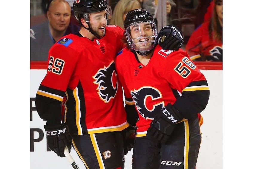 Calgary Flames No. 1 line Sean Monahan, Elias Lindholm and Johnny Gaudreau celebrate a goal.