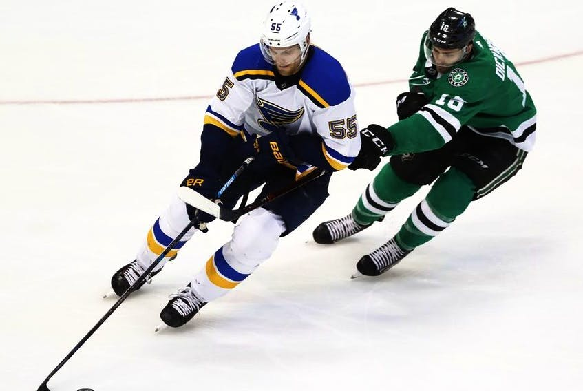 St. Louis Blues' Colton Parayko handles the puck as Dallas Stars' Jason Dickinson defends during the third period in Game 4 of an NHL second-round hockey playoff series, Wednesday, May 1, 2019, in Dallas.