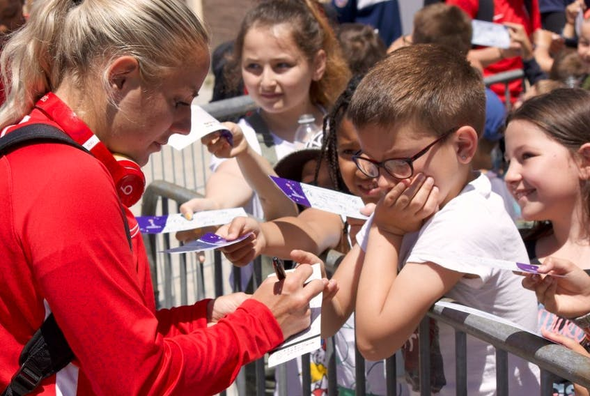 Canadian striker Adriana Leon signs an autograph following a training session at the Complexe Sportif de Laverune in Laverune, France on Thursday June 6, 2019. Canada open the FIFA 2019 Women's World Cup against Cameroon on Monday in Montpellier, France.