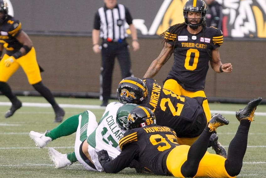 Saskatchewan Roughriders quarterback Zach Collar is hit late by Hamilton Tiger-Cats' Simoni Lawrence after Collaros was downed by Tiger-Cats' Julian Howsare during first half CFL football game action in Hamilton on Thursday, June 13, 2019.