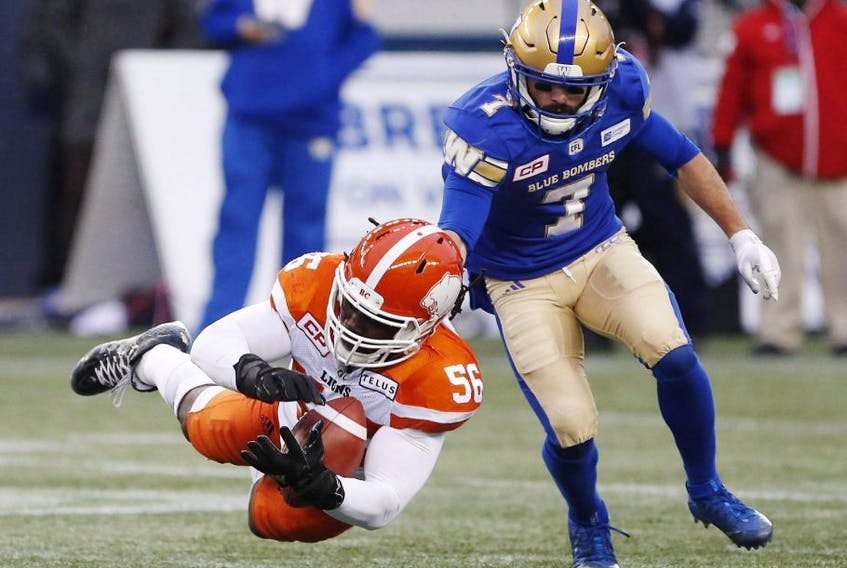 Lions' Solomon Elimimian (left) can't hold onto a pass intended for Blue Bombers' Weston Dressler (right) during the CFL action in Winnipeg on Oct. 28, 2017.