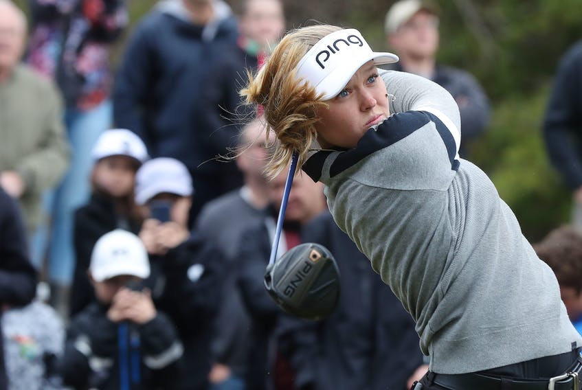 LPGA Tour star Brooke Henderson hits some balls during a demonstration for kids at the Eagle Creek Golf Club in Dunrobin, Ont., on Tuesday. Henderson was attending the Kevin Haime Kids to the Course Classic.