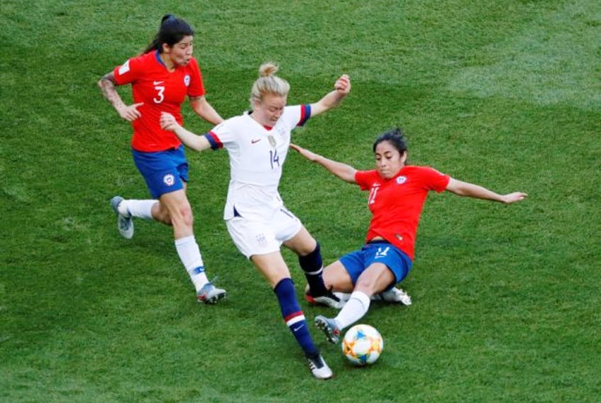 Emily Sonnett of the U.S., centre, in action against Chile's Carla Guerrero and Yessenia Lopez during the Women's World Cup Group F match at Parc des Princes in Paris on Sunday, June 16, 2019. (Gonzalo Fuentes / Reuters)