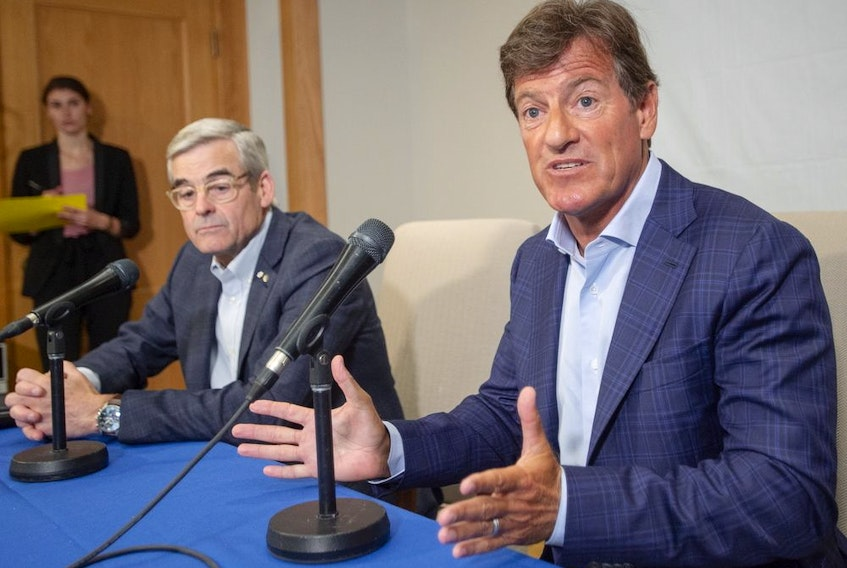 Stephen Bronfman, right, and Pierre Boivin, along with Baseball Montreal are working on a deal to have the Tampa Bay Rays play half their home games in Florida and the other half in Montreal.
