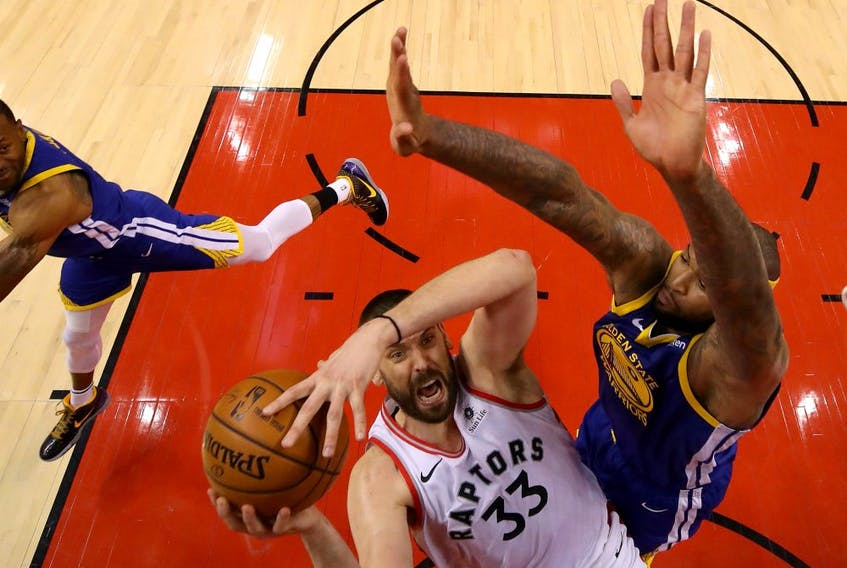 Marc Gasol #33 of the Toronto Raptors attempts a shot against DeMarcus Cousins #0 of the Golden State Warriors during Game Five of the 2019 NBA Finals at Scotiabank Arena on June 10, 2019 in Toronto, Canada.