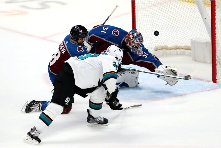 San Jose Sharks sniper Logan Couture scores his first of three goals on the night in a 4-2 victory over the Colorado Avalanche last night at Pepsi Center in Denver.