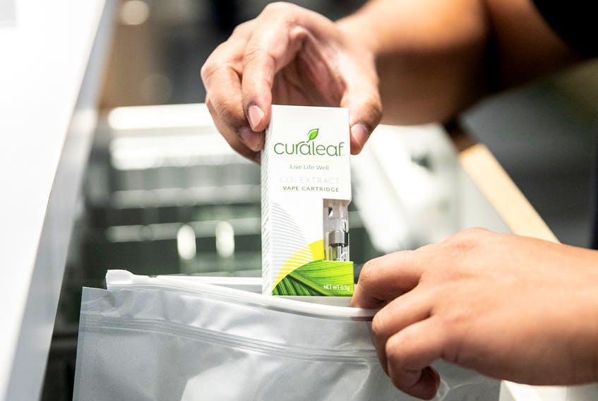 An employee puts a vape cartridge in a bag at a Curaleaf Inc. store in the Queens borough of New York.