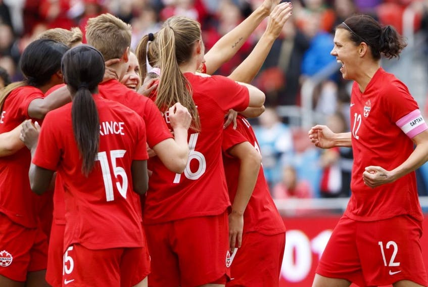 Team Canada captain Christine Sinclair (12) celebrates a goal by midfielder Jessie Fleming (17) during the first half of a women's international soccer friendly against Mexico at BMO field in Toronto, Saturday, May 18, 2019.