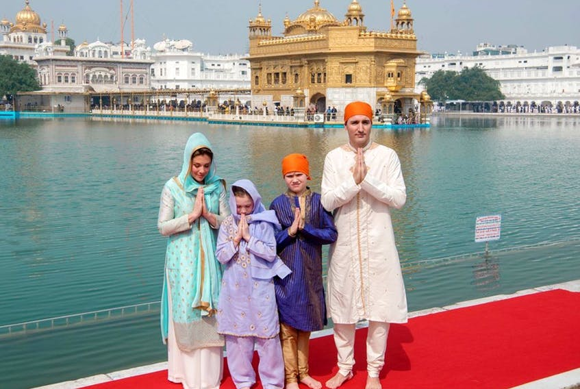 In this handout photo, Prime Minister Justin Trudeau (R), along with his wife Sophie Gregoire Trudeau (L), daughter Ella-Grace (2nd L) and son Xavier (2nd R) pose for a family photo as they pay their respects at the Sikh Golden Temple in Amritsar on Feb. 21, 2018.