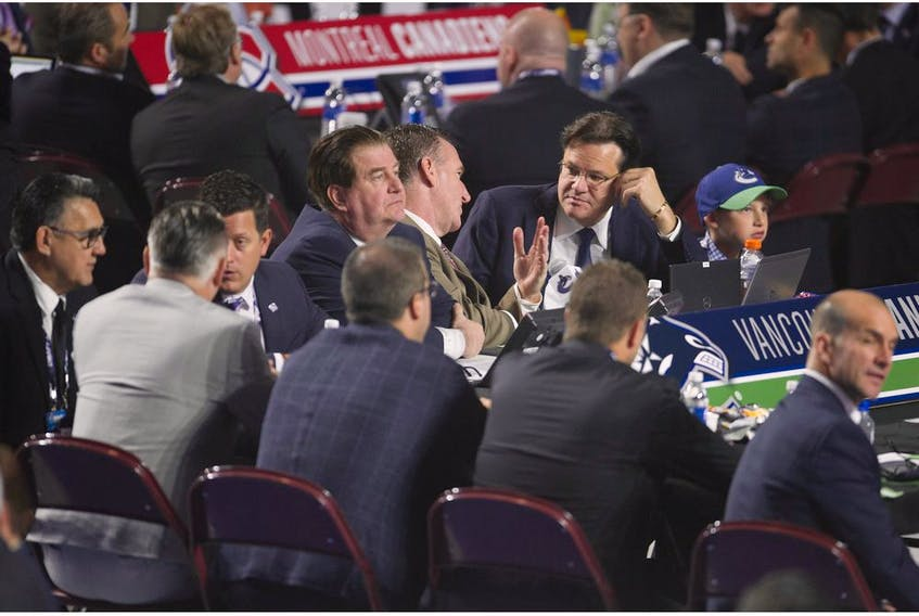 Jim Benning, Francesco Aquilini and some of the Vancouver Canucks' scouting staff at the 2019 NHL Entry Draft in Vancouver.