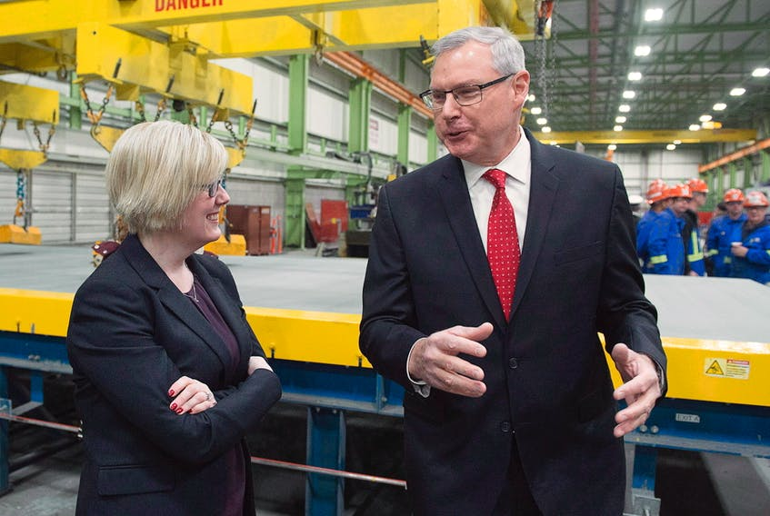 Irving Shipbuilding president Kevin McCoy, right, and Public Services Minister Carla Qualtrough chat at a ceremony where the first piece of steel was cut on the third Arctic patrol vessel for the Royal Canadian Navy, in Halifax on Tuesday, Dec. 19, 2017. Irving is building five to six Arctic patrol vessels under Ottawa's national shipbuilding strategy.