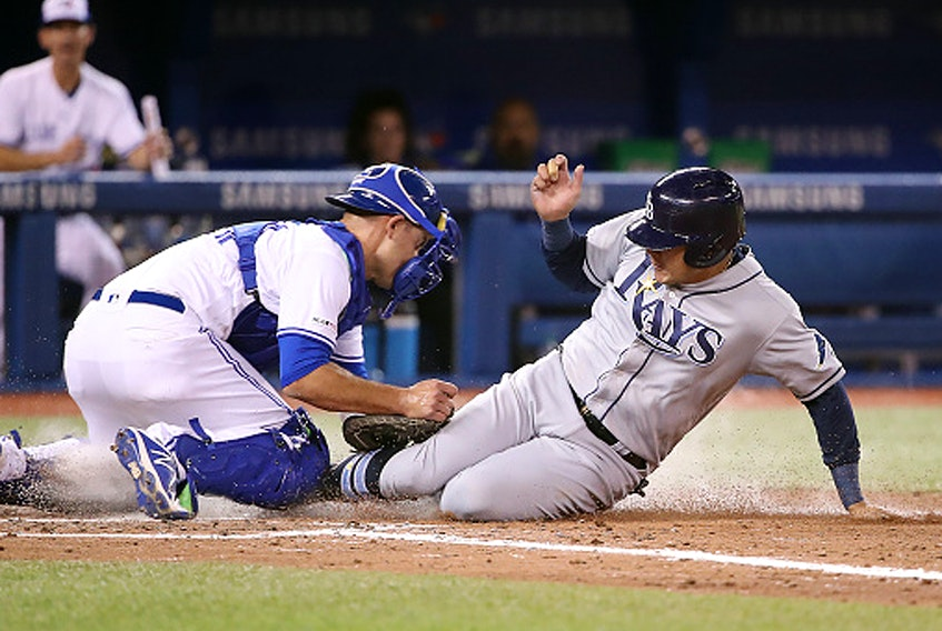 Jonathan Davis of the Toronto Blue Jays steals second base against Daniel Robertson of the Tampa Bay Rays at the Rogers Centre on September 29, 2019 in Toronto. (Mark Blinch/Getty Images)