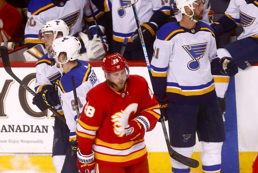 Calgary Flames Elias Lindholm reacts after losing to the St. Louis Blues 3-1 at the Scotiabank Saddledome in Calgary on Saturday December 22, 2018. Darren Makowichuk/Postmedia