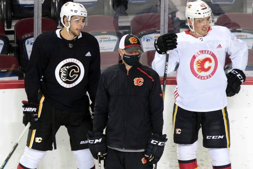 Calgary Flames Connor Mackey, left and Glenn Gawdin take part in the team's first practice since the COVID-19 shutdown at the Scotiabank Saddledome in Calgary on Monday, July 13, 2020.  Gavin Young/Postmedia