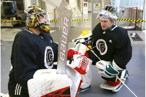 Calgary Flames goalies, L-R, Tyler Parsons and Dustin Wolf get ready to hit the ice during the Flames annual development camp at WinSport Canada in Calgary on Saturday, July 6, 2019. Darren Makowichuk/Postmedia