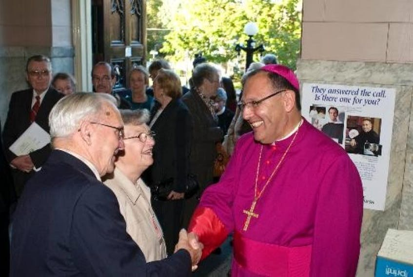 Bishop Richard Grecco greets Harry and Mary Nabuurs of Montague at a reception at St. Dunstans Basilica in Charlottetown on Monday. Grecco moves from Toronto to lead the approximately 65,000 Roman Catholic faithful on Prince Edward Island. Guardian photo by Nigel Armstrong