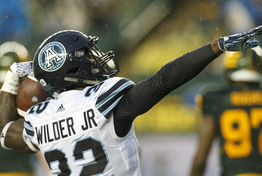 Toronto Argonauts running back James Wilder Jr. (32) celebrates a touchdown against the Edmonton Football Team at Commonwealth Stadium on July 13, 2018.