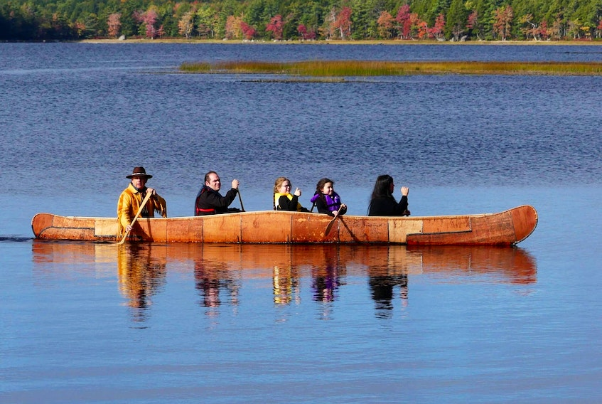 Melissa Labrador's family in 21-foot ocean birch bark canoe. - Mike Sanders (photo submitted October 2020)