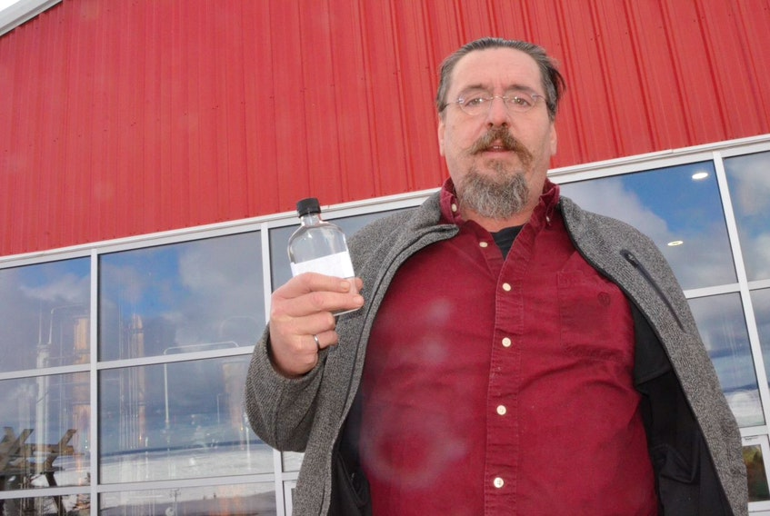 Thomas Steinhart, owner of Steinhart Distillery, holds a mickey bottle of hand sanitizer Monday, March 16, 2020 that his business has started to produce at the Arisaig, Antigonish County, facility.