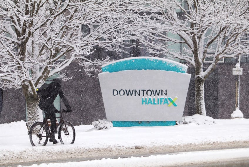 A cyclist pedals near downtown Halifax during a snowstorm Wednesday, Jan. 8, 2019.