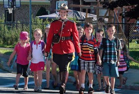 RCMP Const. Heidi Stevenson, who was killed in Sunday's shooting rampage, takes part in an RCMP promotion for crosswalk and school zone safety. This photo was posted to the Nova Scotia RCMP's Facebook page on Sept. 2, 2015