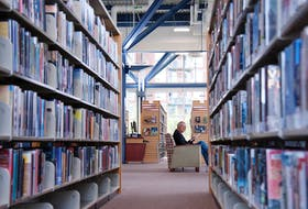 A man reads at the Keshen Goodman Public Library in Halifax, May 28, 2015.