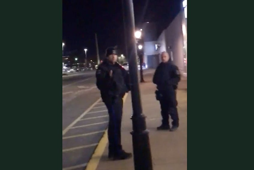 A screengrab from a smartphone video taken by a black teenager, who started recording after two Halifax police officers threatened him with arrest outside the Bedford Place Mall in Bedford on Friday night, Feb. 21, 2020.