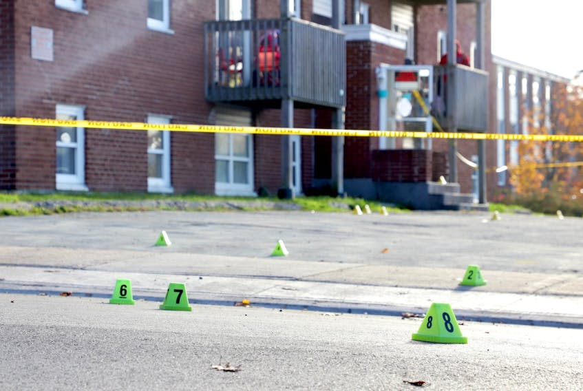 Evidence markers and police tape are visible outside an apartment building on Primrose Street in Dartmouth on Oct. 23, 2020, after the killing of Zachery Grosse, 25.