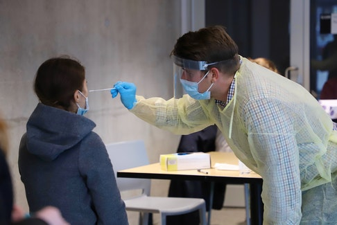 A rapid COVID-19 test is administered at a drop-in temporary testing site set up on Morris Street in Halifax on Tuesday, Nov. 24, 2020.