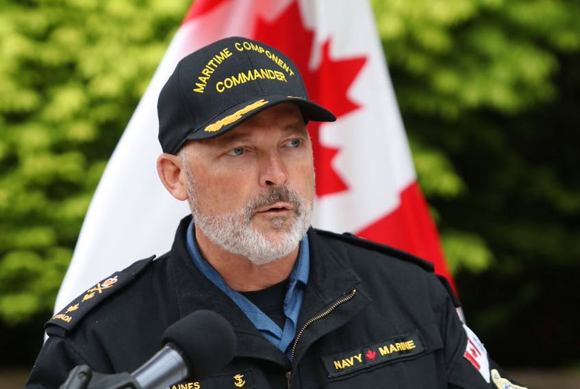Rear Admiral Craig Baines, Maritime Component commander, speaks at the podium at the Navy Dockyard in Halifax on Wednesday, June 3, 2020. The Royal Canadian Navy and the Royal Canadian Air Force has concluded their recovery efforts of the CH-148 Cyclone and its crew that crashed off the coast of Greece on April 29.
