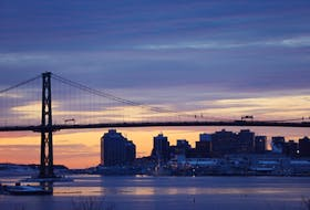 The sun rises behind the Angus L. Macdonald bridge and Halifax skyline on a cold Friday morning, Jan. 10, 2020.