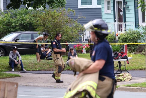 Halifax firefighters wrap up their work after a blaze at an small apartment building at the corner of Connaught and Chebucto avenues Friday morning, July 17, 2020.