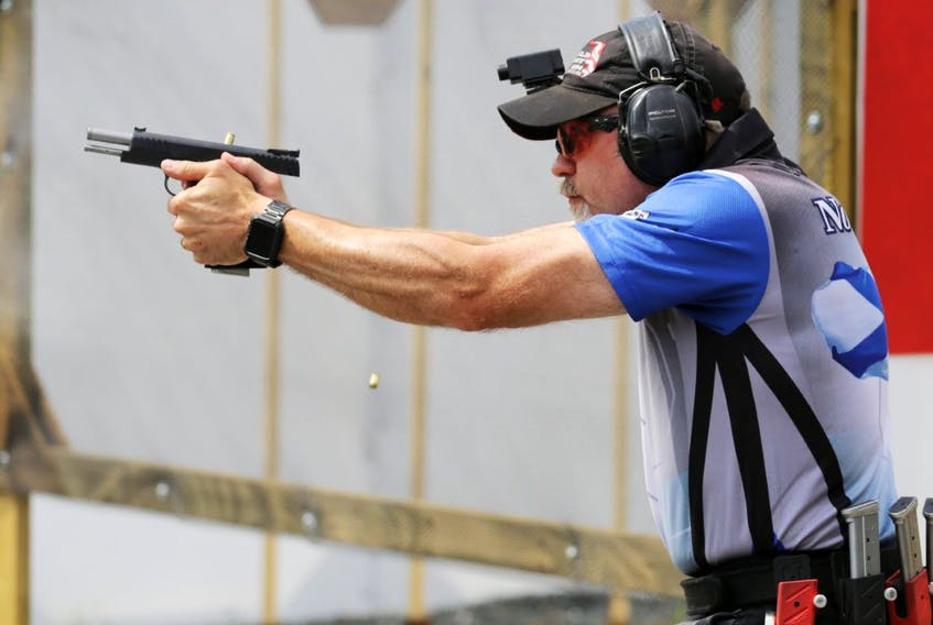 Sean Hansen fires his gun during a national shooting championship at the Ralph Dunn Range on Old Guysborough Road in Devon, N.S., on Friday, July 29, 2016.  Hansen is being investigated as part of a Canada Border Services Agency probe into gun smuggling.  - File