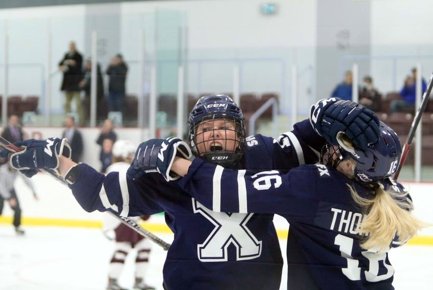 St. FX X-Women's Tyra Meropoulis gets a hug from teammate Jayden Thompson after scoring the team's second goal against the Saint Mary's Huskies early in the second period Tuesday, March 3, 2020.