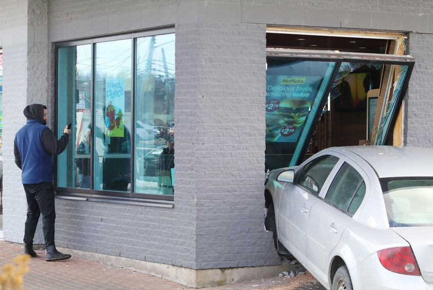 Two people were taken to hospital with undetermined injuries after a vehicle was driven into the McDonald's on Windmill Road in Dartmouth on Wednesday, Feb. 24, 2021. Police on scene said the table next to the window was blocked off for social distancing, but there was a couple at the adjoining table.