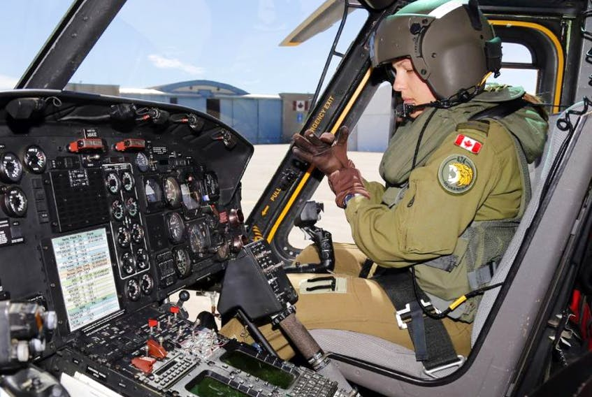 Capt. Stef Pouliot prepares to co-pilot a flight in a CH-146 Griffon helicopter at Canadian Forces Base Trenton, Ont., June 16, 2016. - Luke Hendry / The Intelligencer