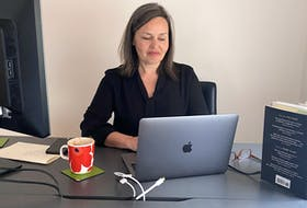 Asa Kachan, chief librarian with Halifax Public Libraries, works from home this week. The library has introduced a number of creative initiatives to keep people connected. - David Kachan