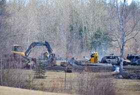 Firefighters work at the scene of a burnt-out home on the Hunter Road near Wentworth, where multiple people are suspected to have been killed by Gabriel Wortman.