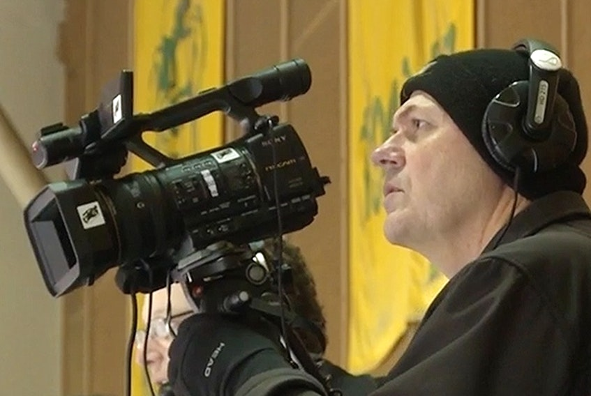 Rob Zittlau films a University of Alberta hockey game at Clare Drake Arena in this undated file photo taken over the last decade. On Sunday, he and his wife, Grace, died in a highway collision near Legal, Alta.