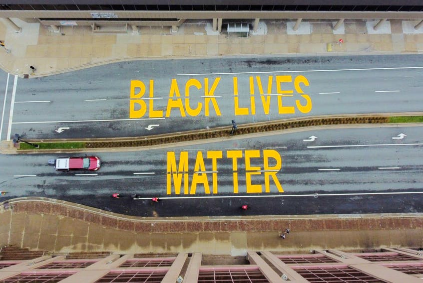 The Black Lives Matter street art that was painted by Halifax Regional Municipality on Alderney Drive, between Queen and Ochterloney streets in Dartmouth, as seen from a drone's-eye view Sunday, Sept. 27, 2020. A similar work appears on Brunswick Street in downtown Halifax.