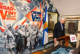 Retired major Ken Hynes, curator of the Army Museum at the Halifax Citadel, speaks at the opening of a Vimy Day anniversary exhibit on April 8, 2016.