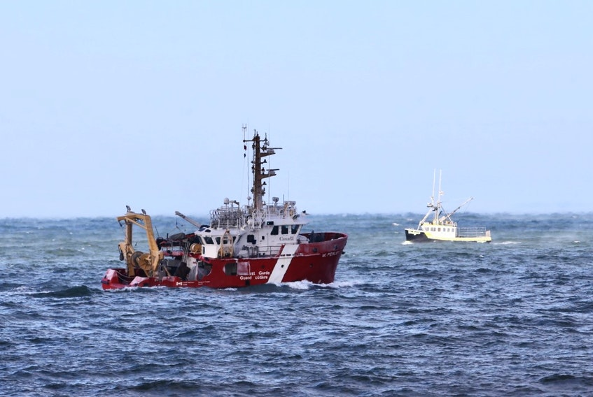 The Canadian Coast Guard Ship M. Perley searches the Bay of Fundy off Hillsburn, Annapolis County, on Wednesday, Dec. 16, 2020 for signs of five missing scallop fishermen or their boat, after the Chief William Saulis went missing early Tuesday morning.