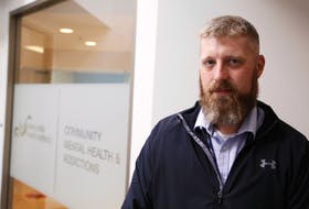 Matt White, the acting program leader of acute care and crisis support at the NSHA central zone. stands outside the community health and addictions office in Halifax on Tuesday, Aug. 18, 2020.