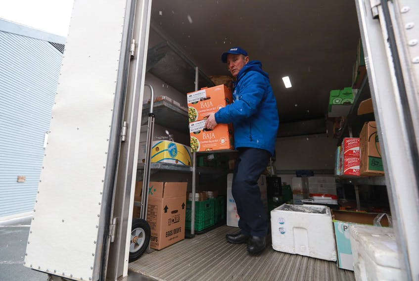 Paul Butler, who works in food distribution with Feed Nova Scotia, brings supplies Thursday afternoon, March 26, 2020 to the kitchen that serves the Metro Turning Point shelter.