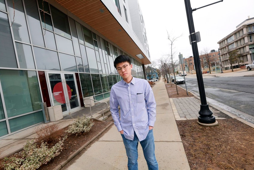 Muyu Lyu, a member of the Dalhousie International Students' Association, stands on campus Wednesday, April 1, 2020.