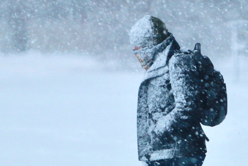 A pedestrian trudges through the heavy snowfall Wednesday morning, Jan. 8, 2020 in Halifax.