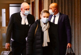 Bassam Al-Rawi, right, a former Halifax taxi driver who was found guilty of sexually assaulting an intoxicated woman in December 2012, and his lawyer Ian Hutchison flank Al-Rawi's wife as they enter Nova Scotia Supreme Court in Halifax on Thursday, Dec. 17, 2020, for Al-Rawi's sentencing hearing.