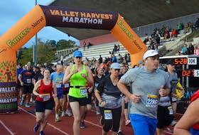 Valley Harvest Marathon runners taking part in the 5 km run depart from Acadia University's Raymond Field.